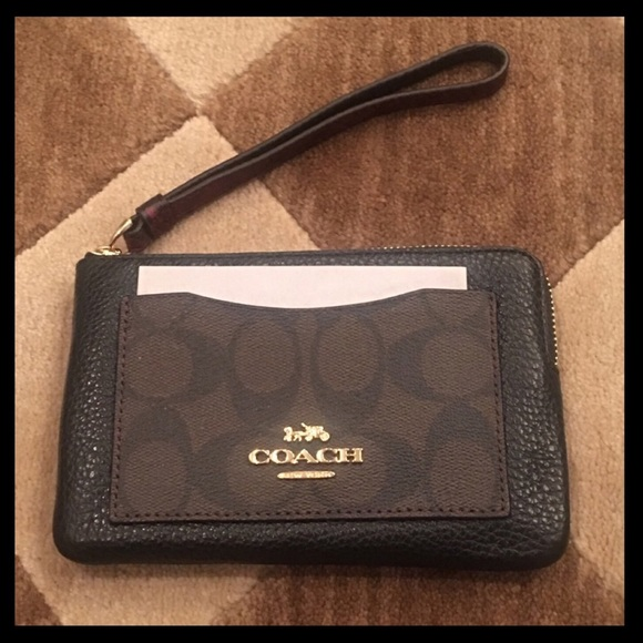 75cd537396d5 COACH wristlet with exterior pocket